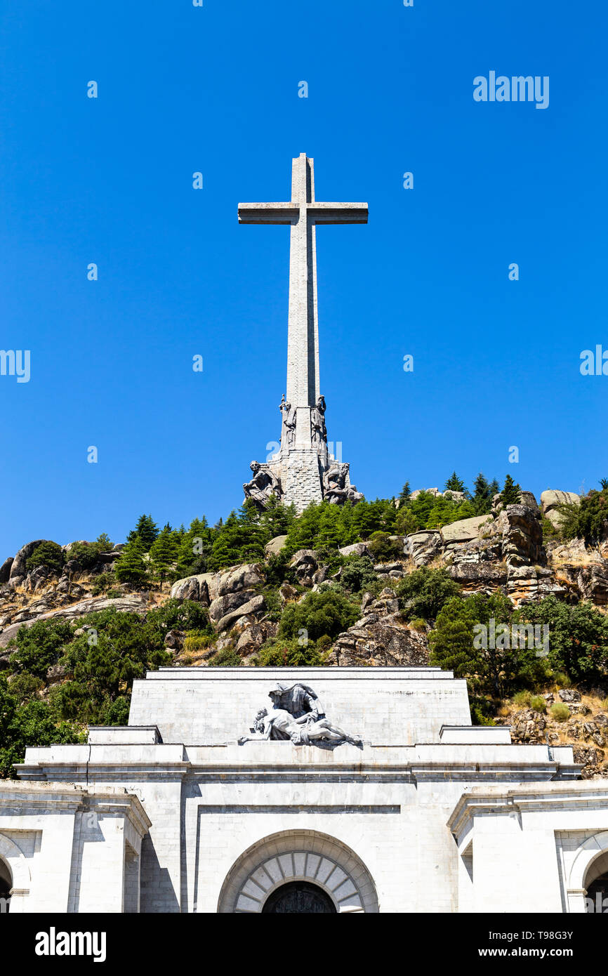 The gigantic cross on the top of the Valley of the Fallen, Valle de Los Caidos , the burying place of the Dictator Franco on the Sierra the Guadarrama - Stock Image