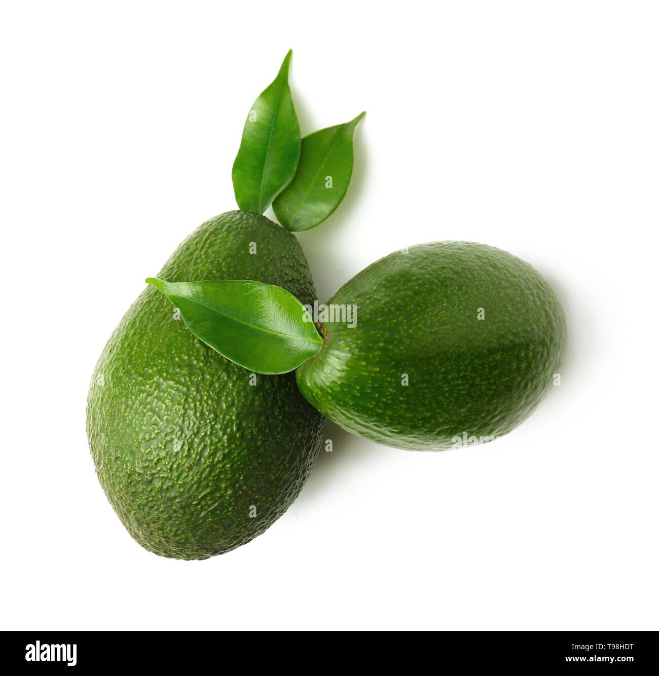 Ripe fresh avocados on white background - Stock Image