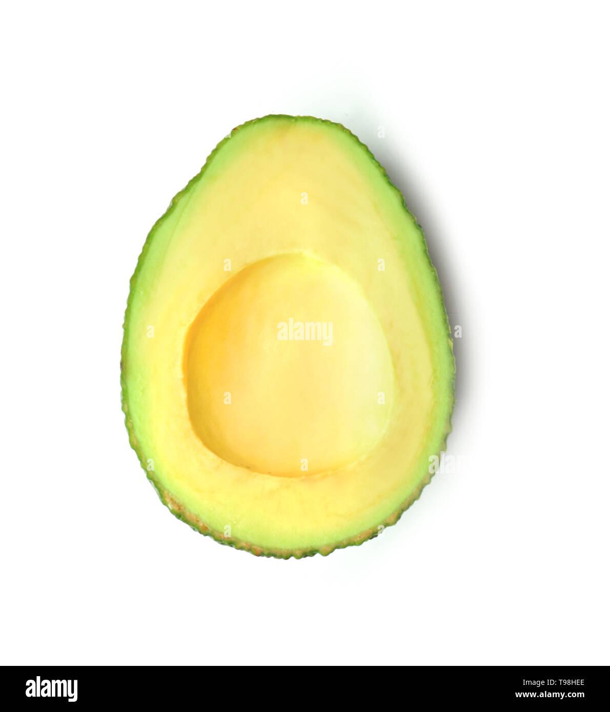 Half of ripe fresh avocado on white background - Stock Image