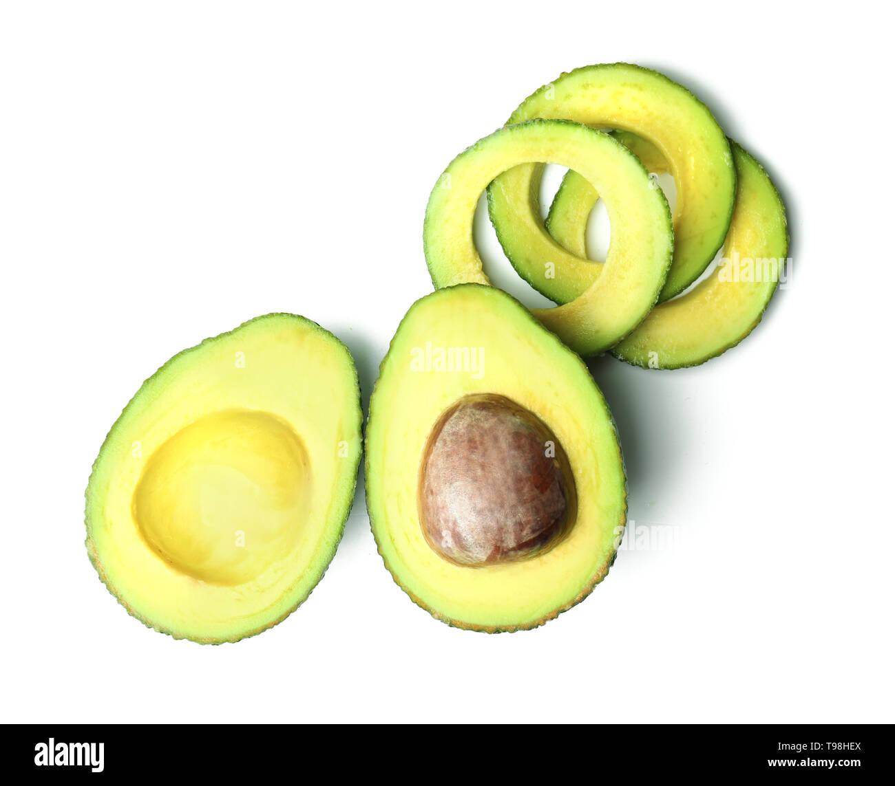 Ripe cut avocado on white background - Stock Image
