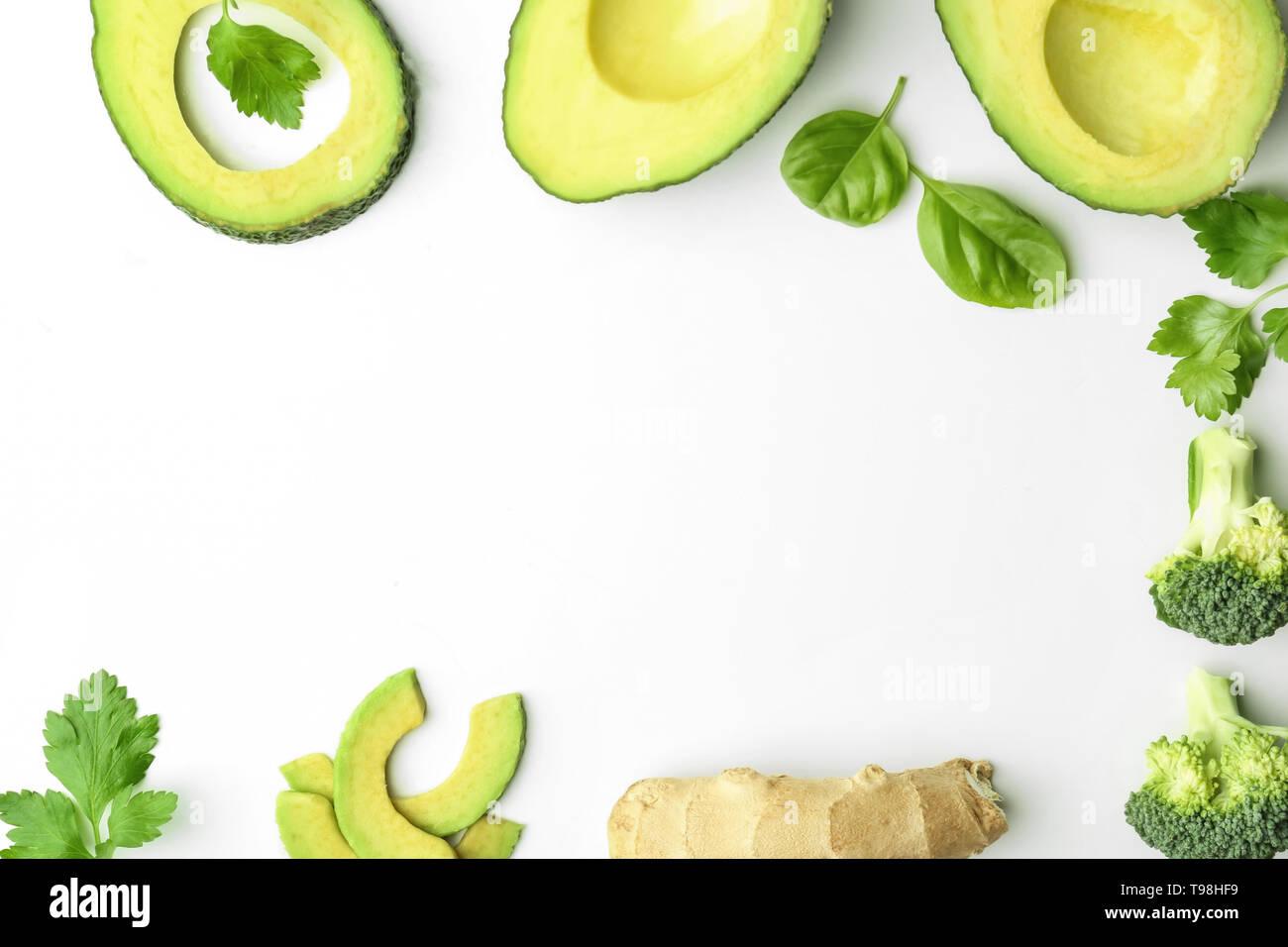 Frame made of sliced avocado on white background - Stock Image