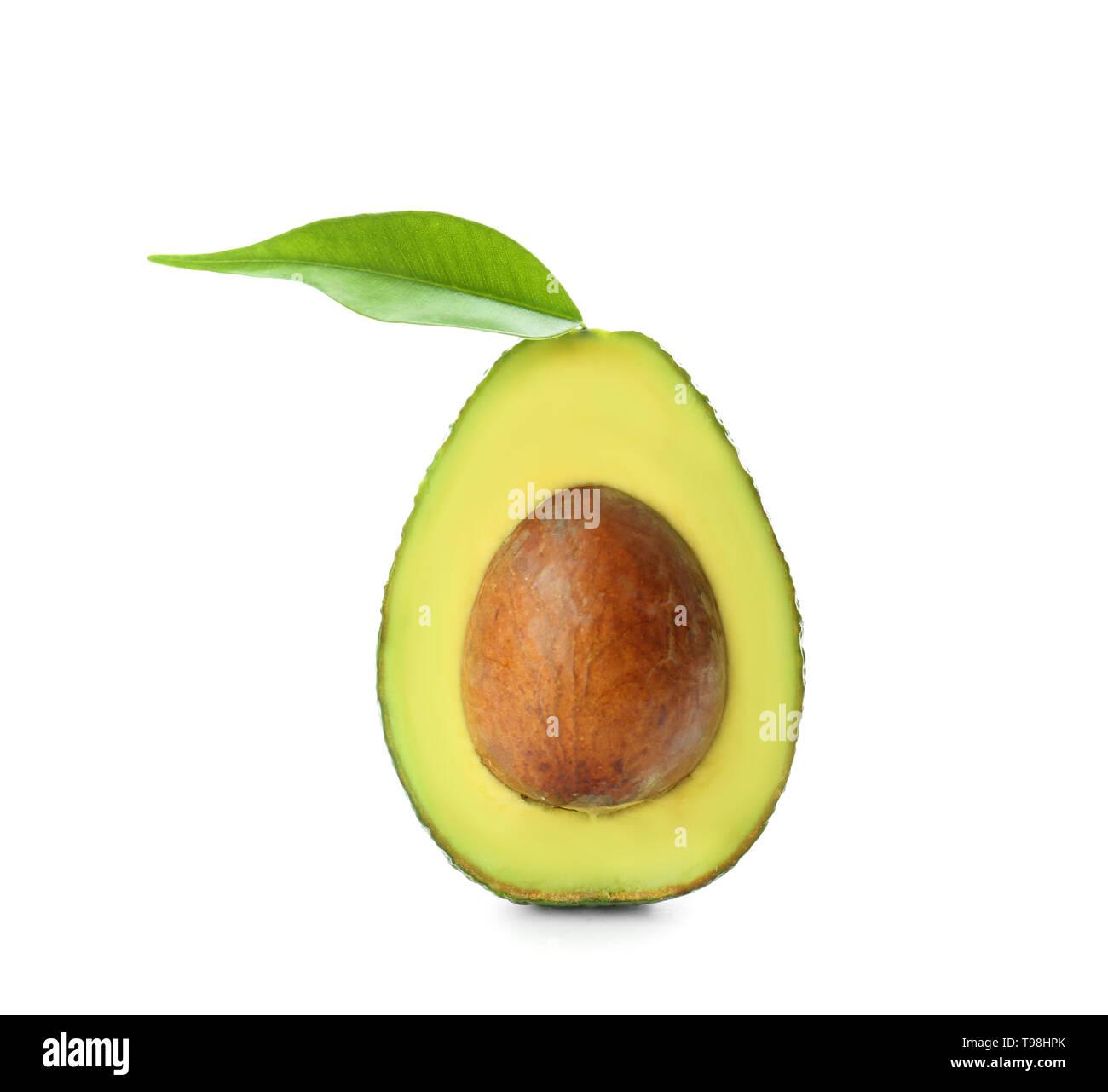 Half of ripe avocado on white background - Stock Image