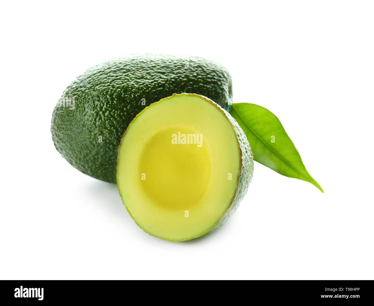 Ripe avocados on white background - Stock Image