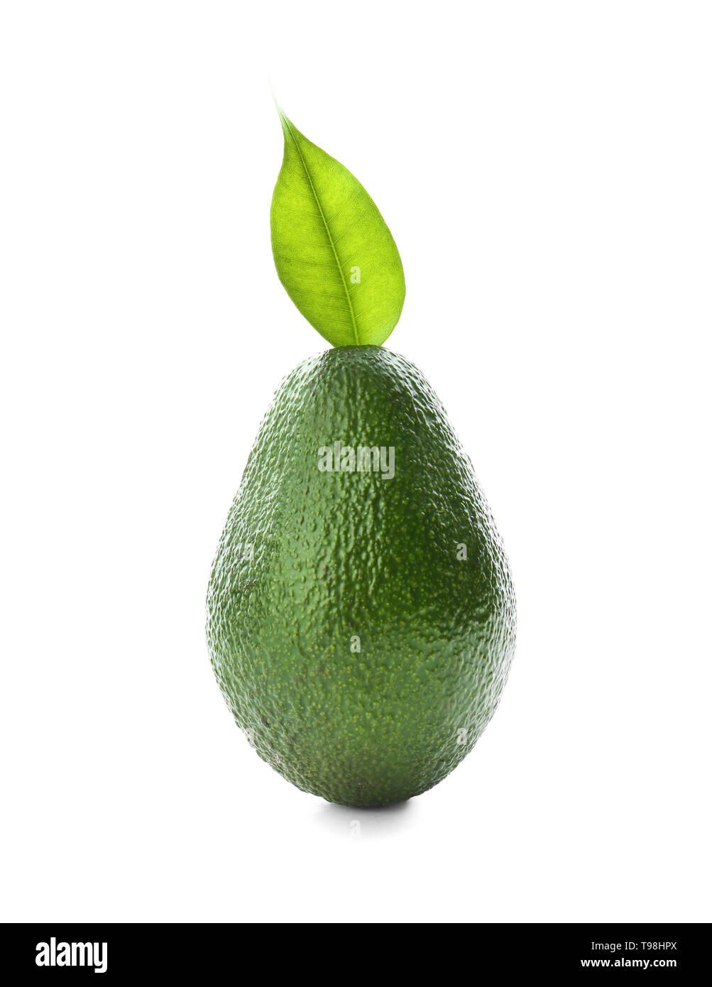 Ripe avocado on white background - Stock Image