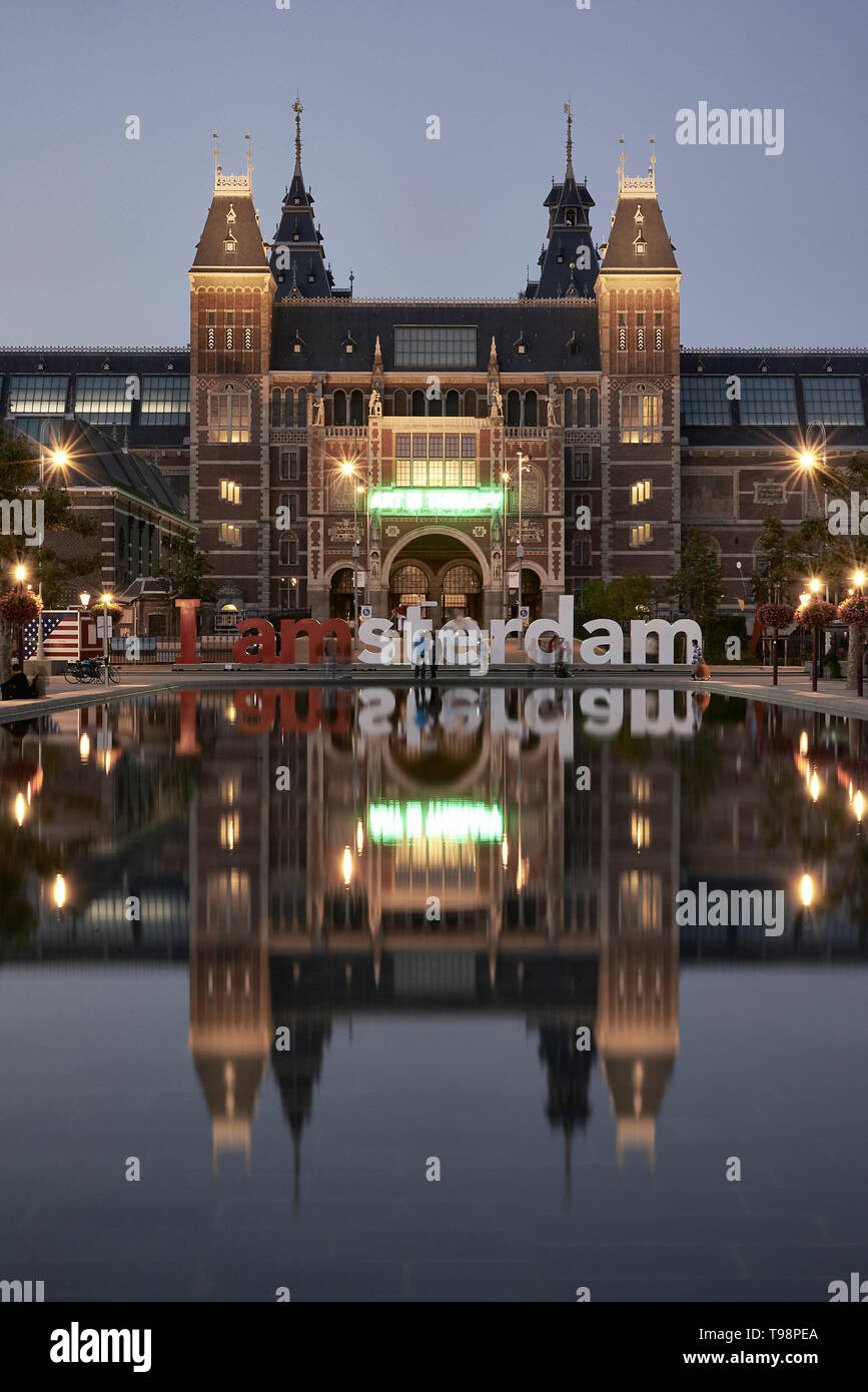 Stunning landscape image of the Rijksmuseum and reflection in the water with the iamsterdam signage in front of the museum - Stock Image