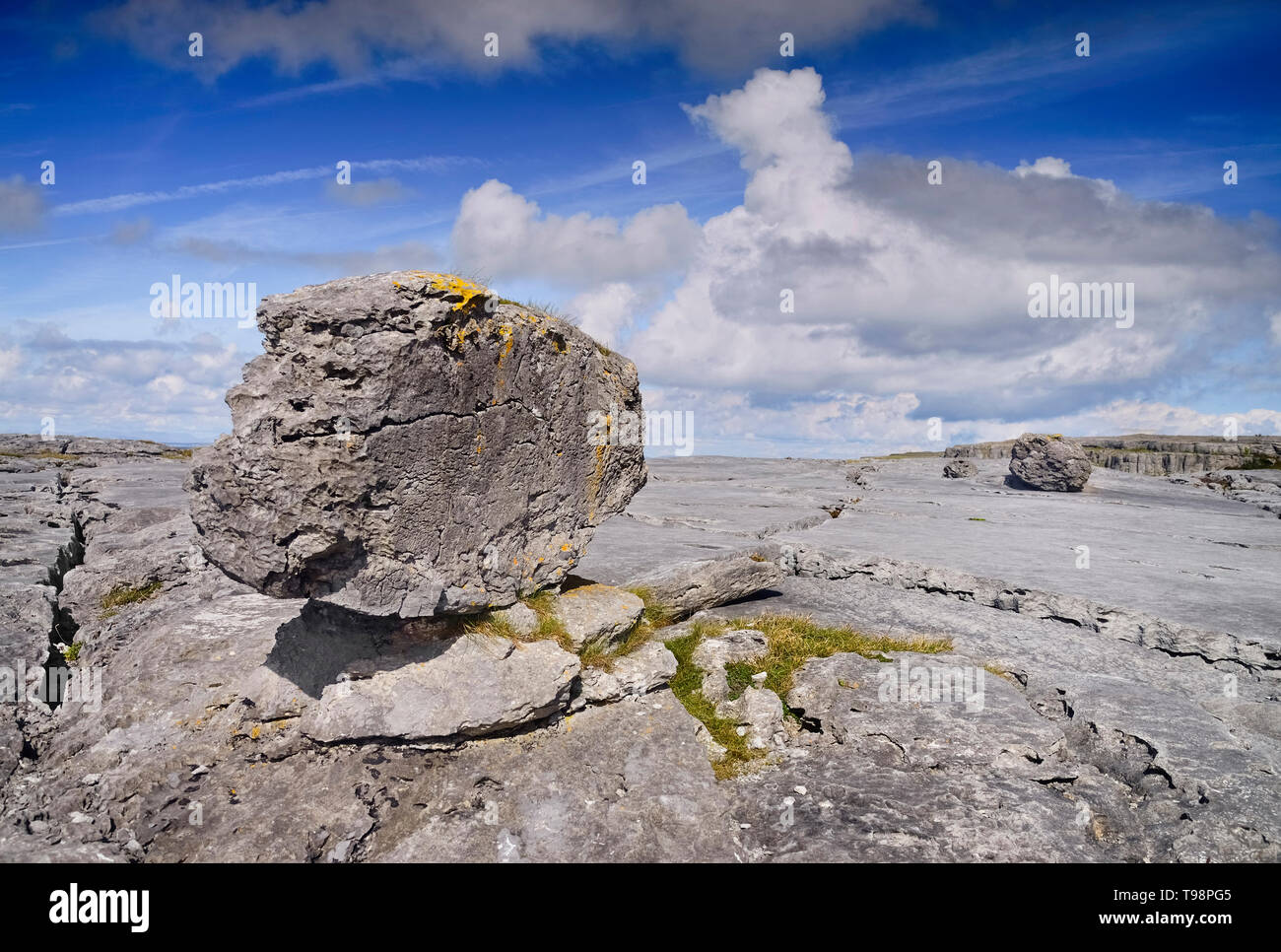 Ireland, County Clare, The Burren,  A single weathered rock sits on typical limestone landscape. - Stock Image