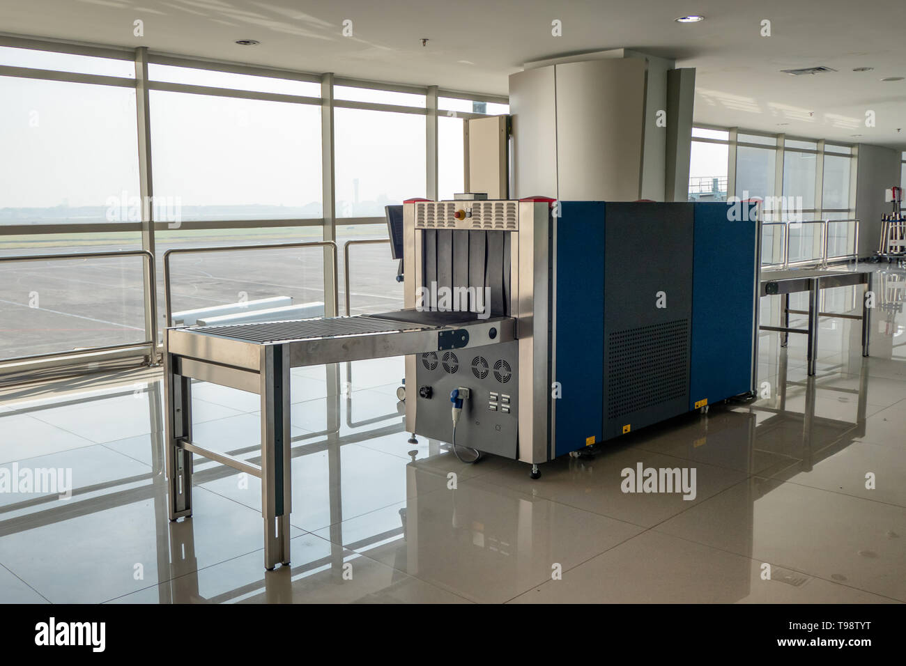 X-ray scanner baggage and metal detectors with conveyor belt in the