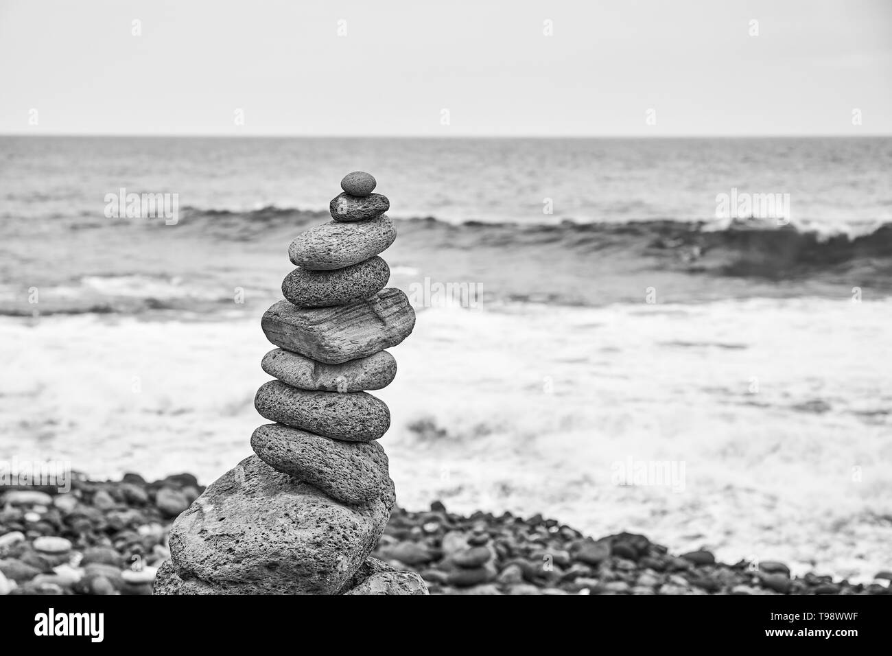 Black and white picture of a stone stack on a beach