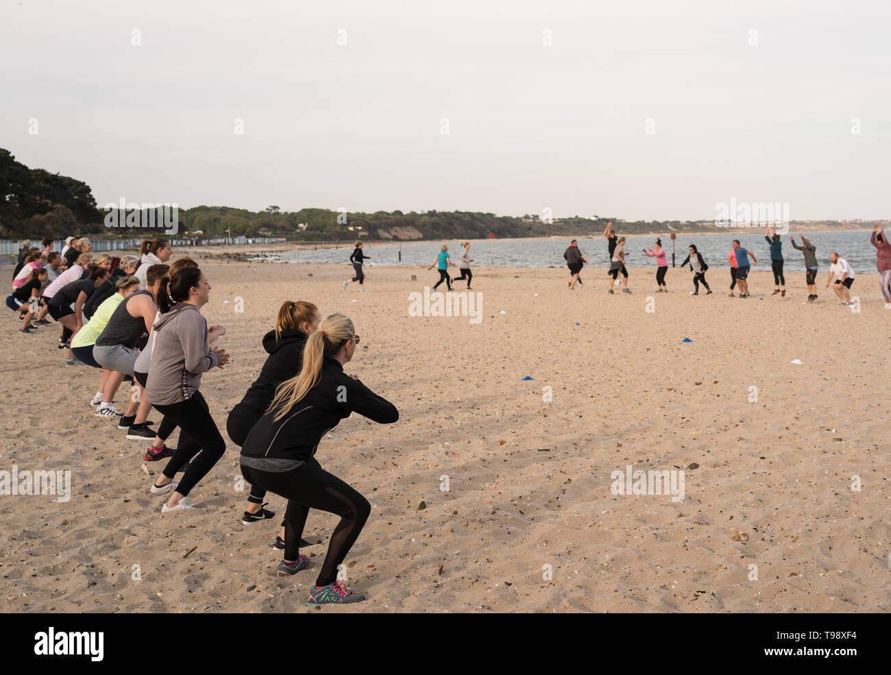 Group exercise on the beach at Avon Beach near Mudeford - Stock Image