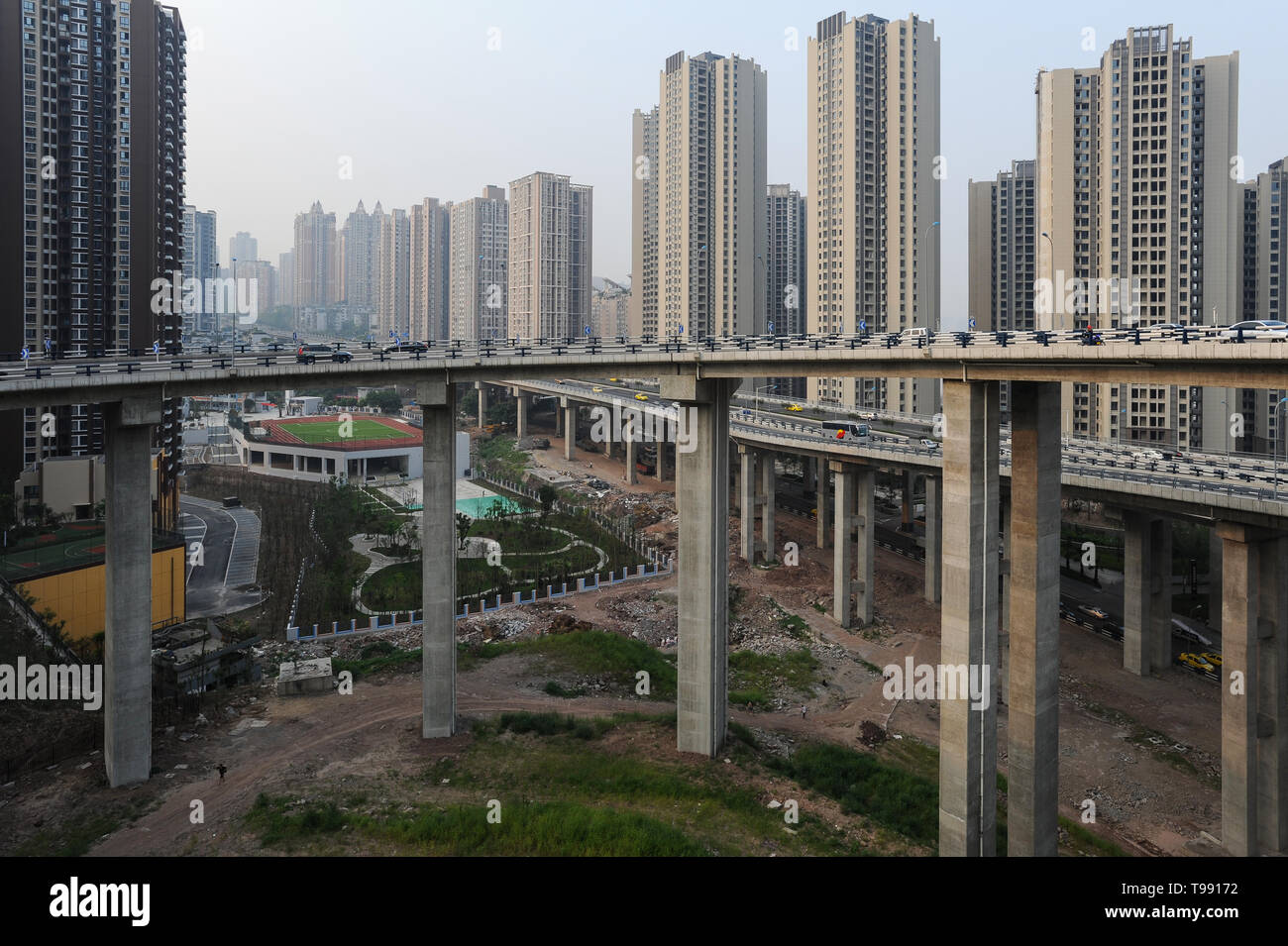 03.08.2012, Chongqing, , China - New skyscraper settlements and highways on the outskirts of the Metrople. The megacity lies at the confluence of two  Stock Photo