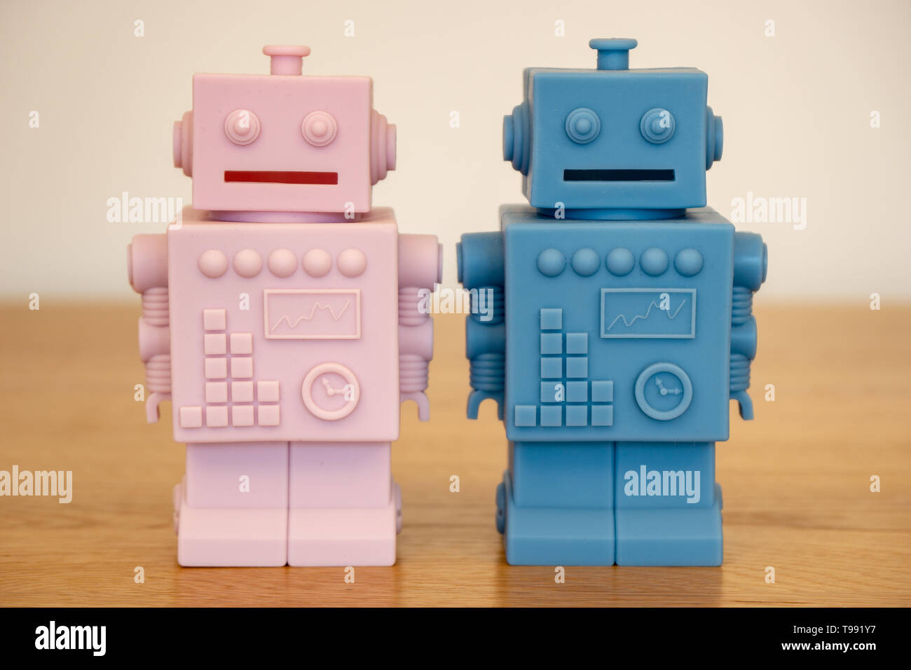 pink and blue robots - male and female Stock Photo