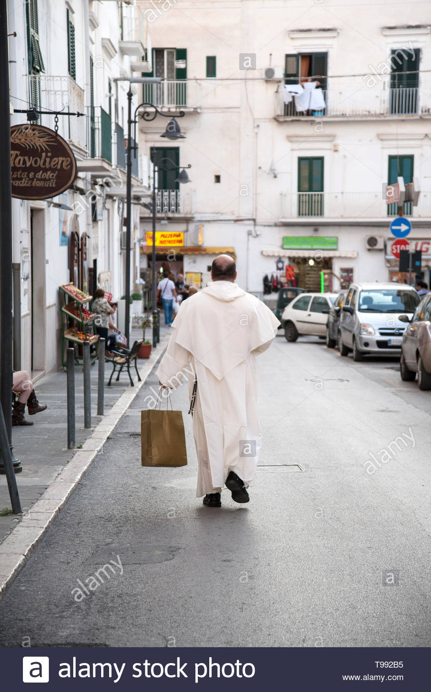 monk shopping in Vieste - Stock Image
