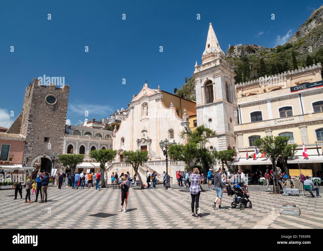 Borgo clock tower and San Giuseppe Church at IX Aprile Square, Corso Umberto, Taormina village, Sicily - Stock Image