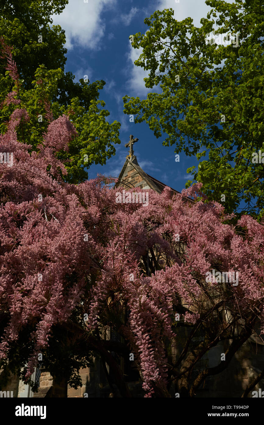 Close-up of cross on church in village of Alcester in the spring sunshine, Vale of Evesham, England, United Kingdom, Europe - Stock Image