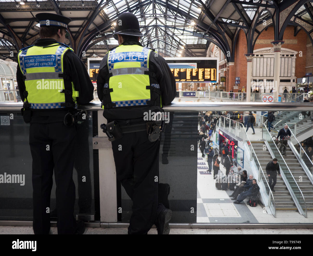 British transport police officer and Community support officer on duty at central London Station Stock Photo