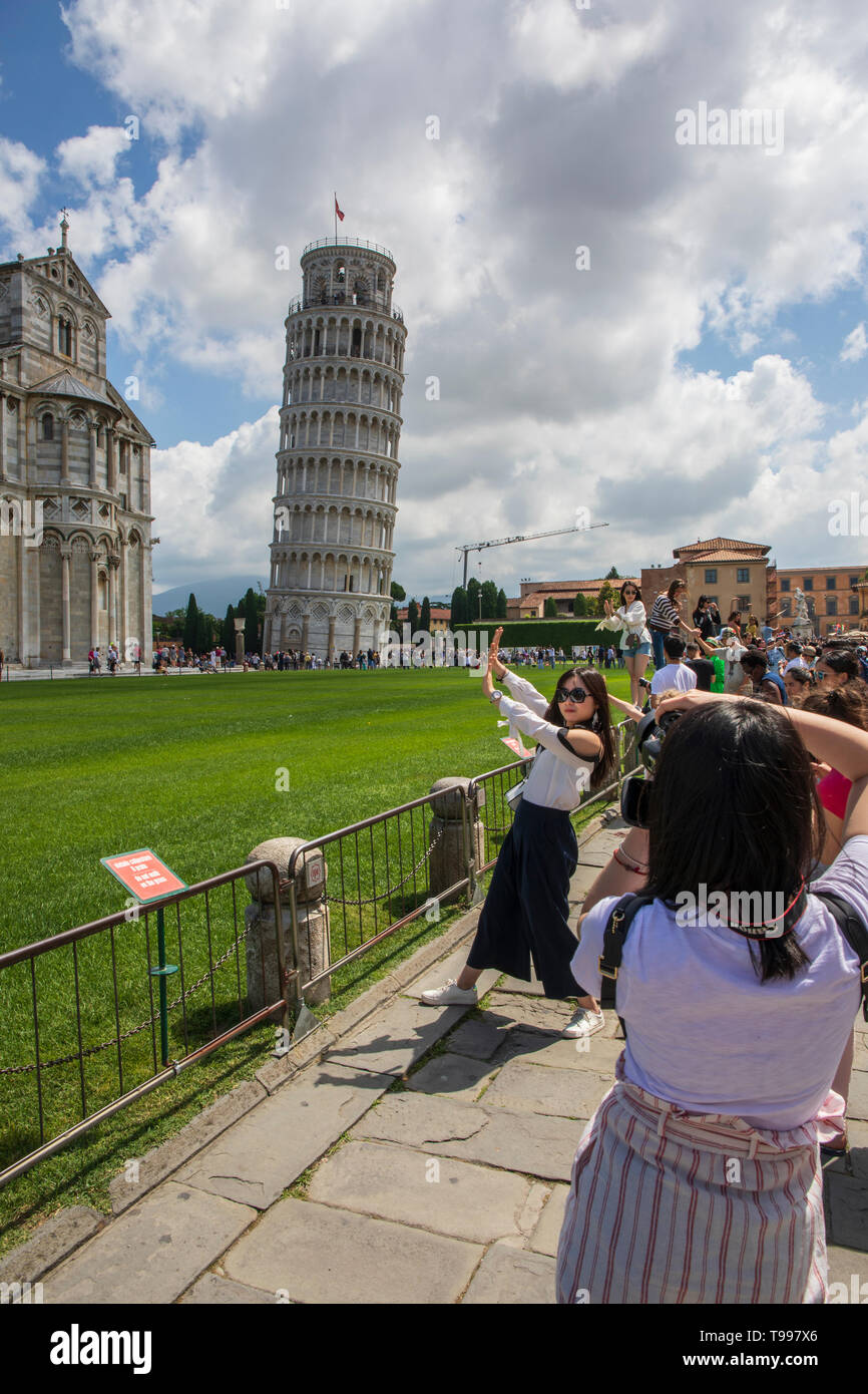 Tourists around the leaning tower of Pisa - Stock Image