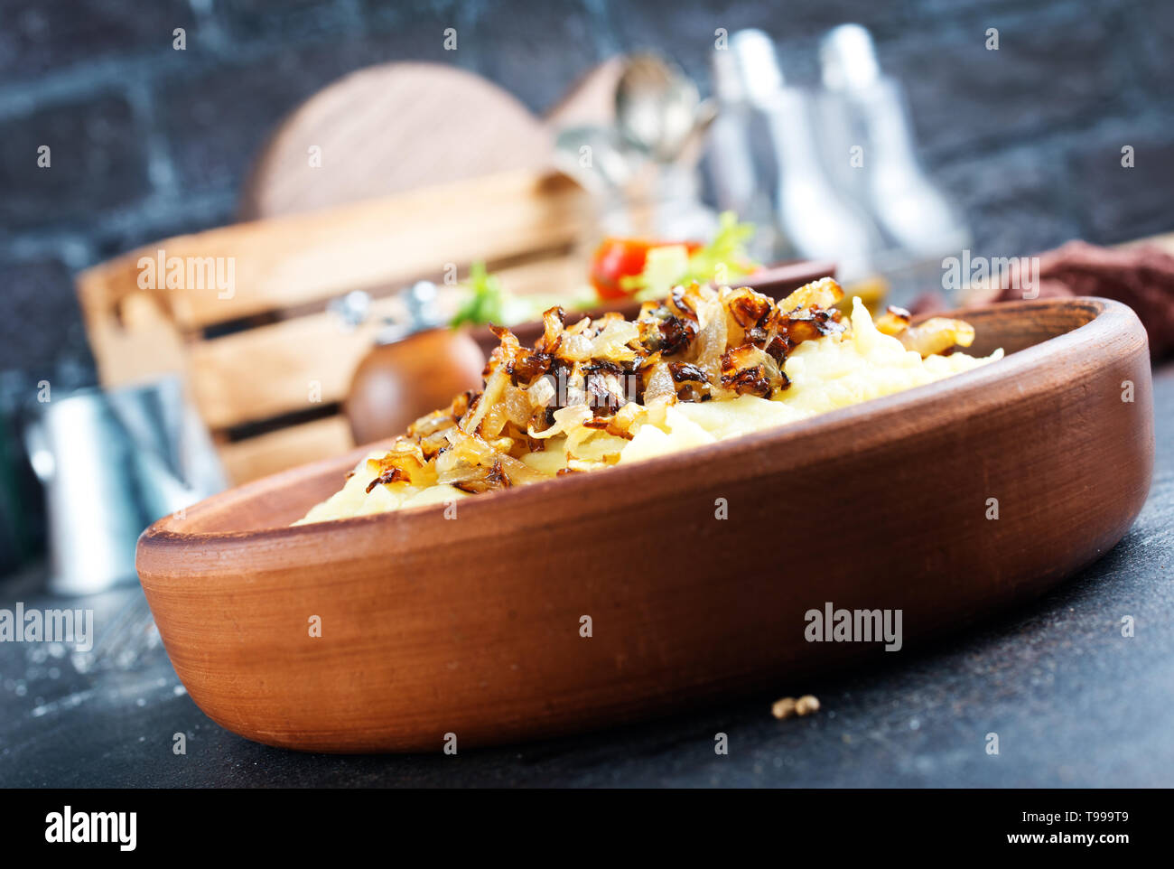 mashed potato with fried onion in bowl - Stock Image