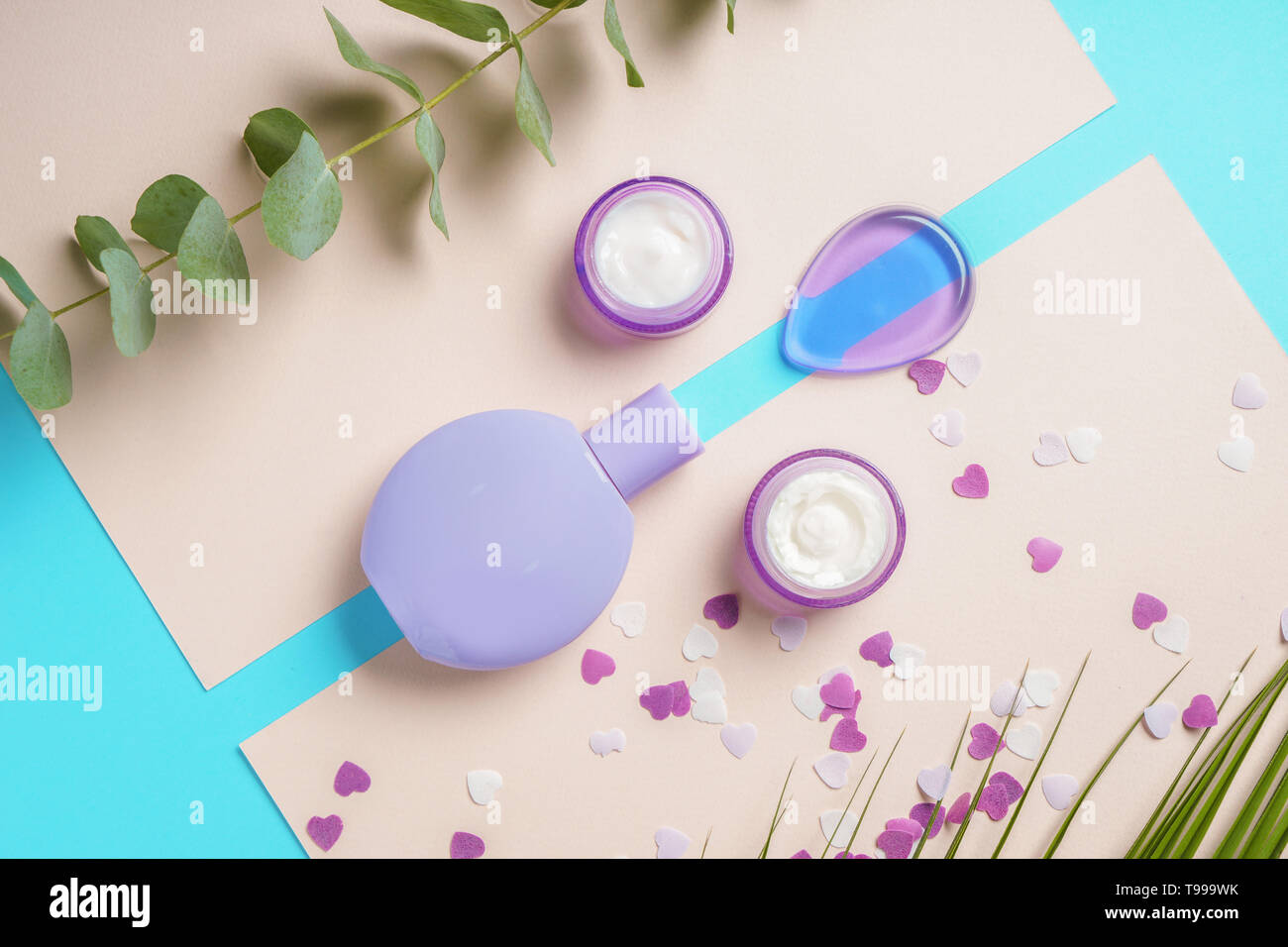Composition with cosmetics on color background - Stock Image