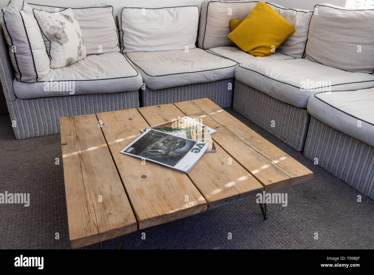 A Modern Light Living Room In And English Home With Wooden Coffee Table And Interior Design Magazines In The Foreground Stock Photo Alamy