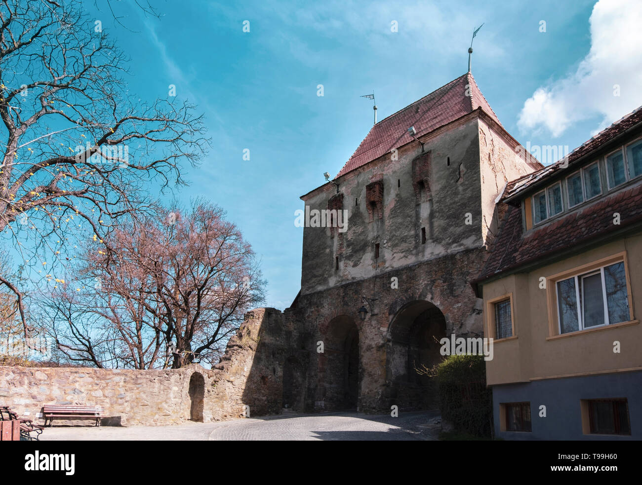 Wide street view of the Tailors Tower, a gate built in the 14th century to defend the entrance to the citadel, on a sunny day in spring. - Stock Image