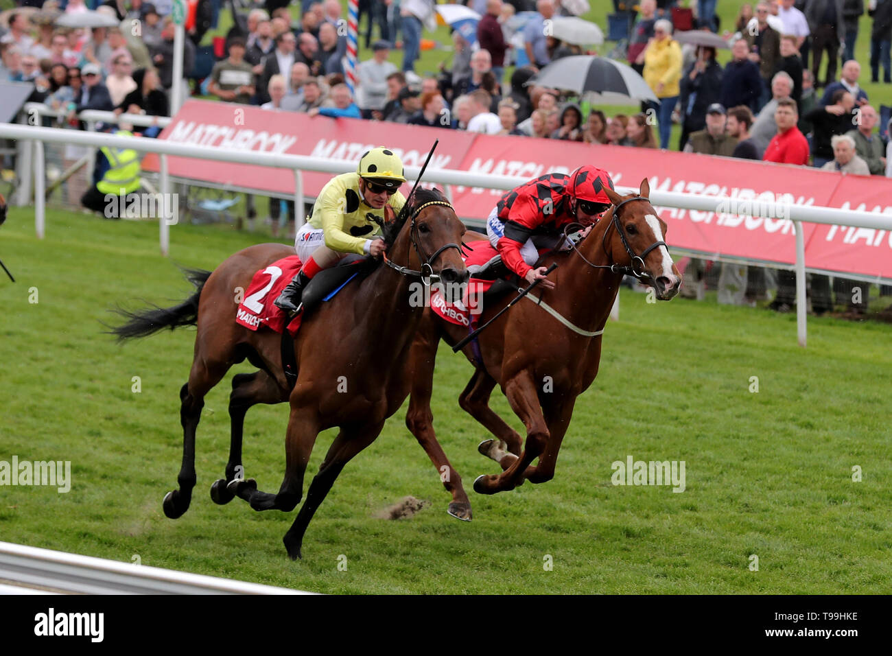 Lucius Tiberius ridden by James Doyle (L)wins the Matchbook Betting Podcast Hambleton Handicap during day three of the Dante Festival at York Racecourse. - Stock Image