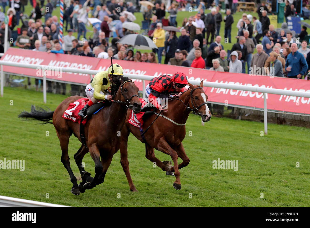 Lucius Tiberius ridden by James Doyle(L) wins the Matchbook Betting Podcast Hambleton Handicap during day three of the Dante Festival at York Racecourse. - Stock Image