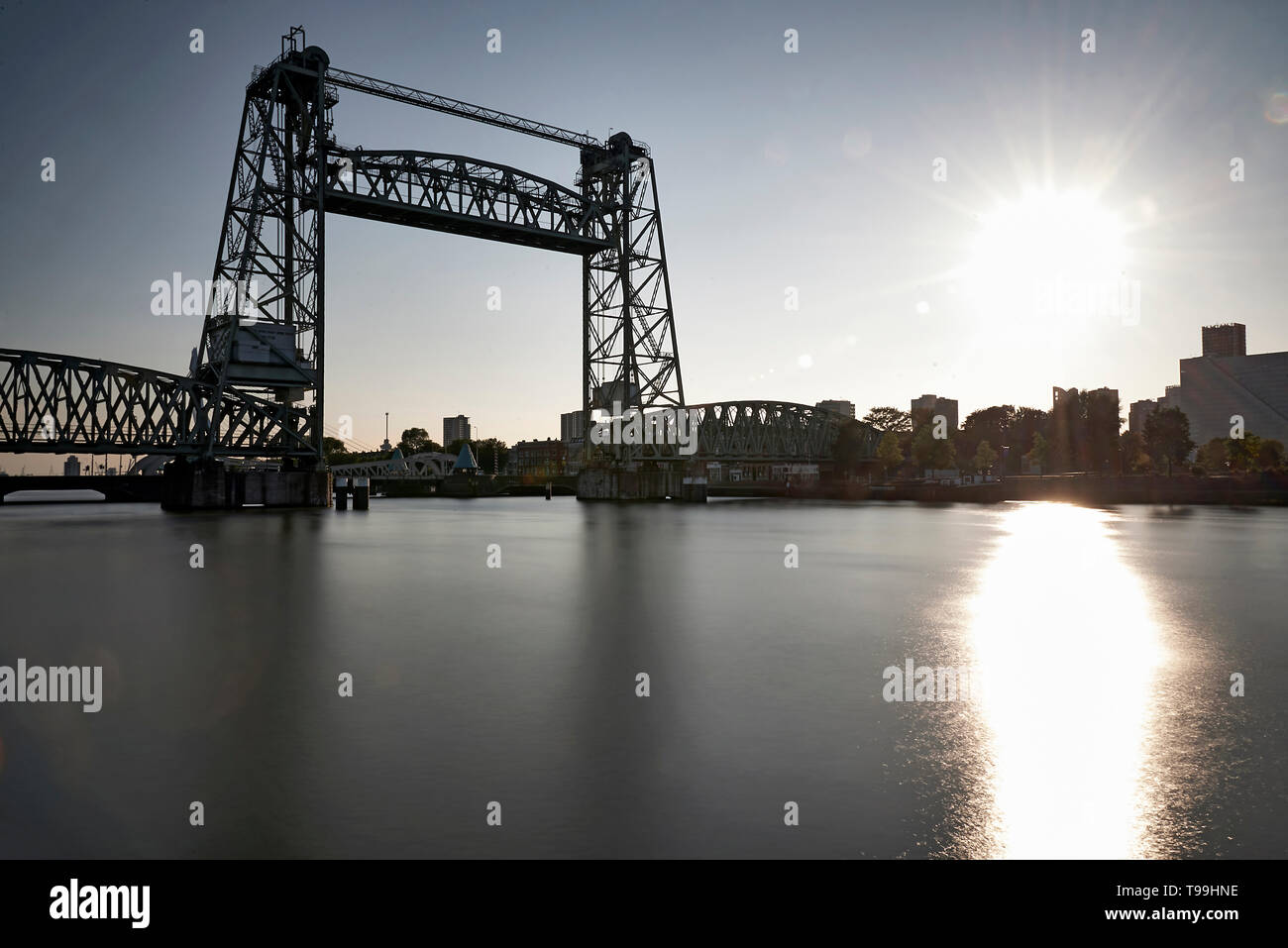 Old vertical lift bridge in the city centre of Rotterdam in spring sunshine - Stock Image
