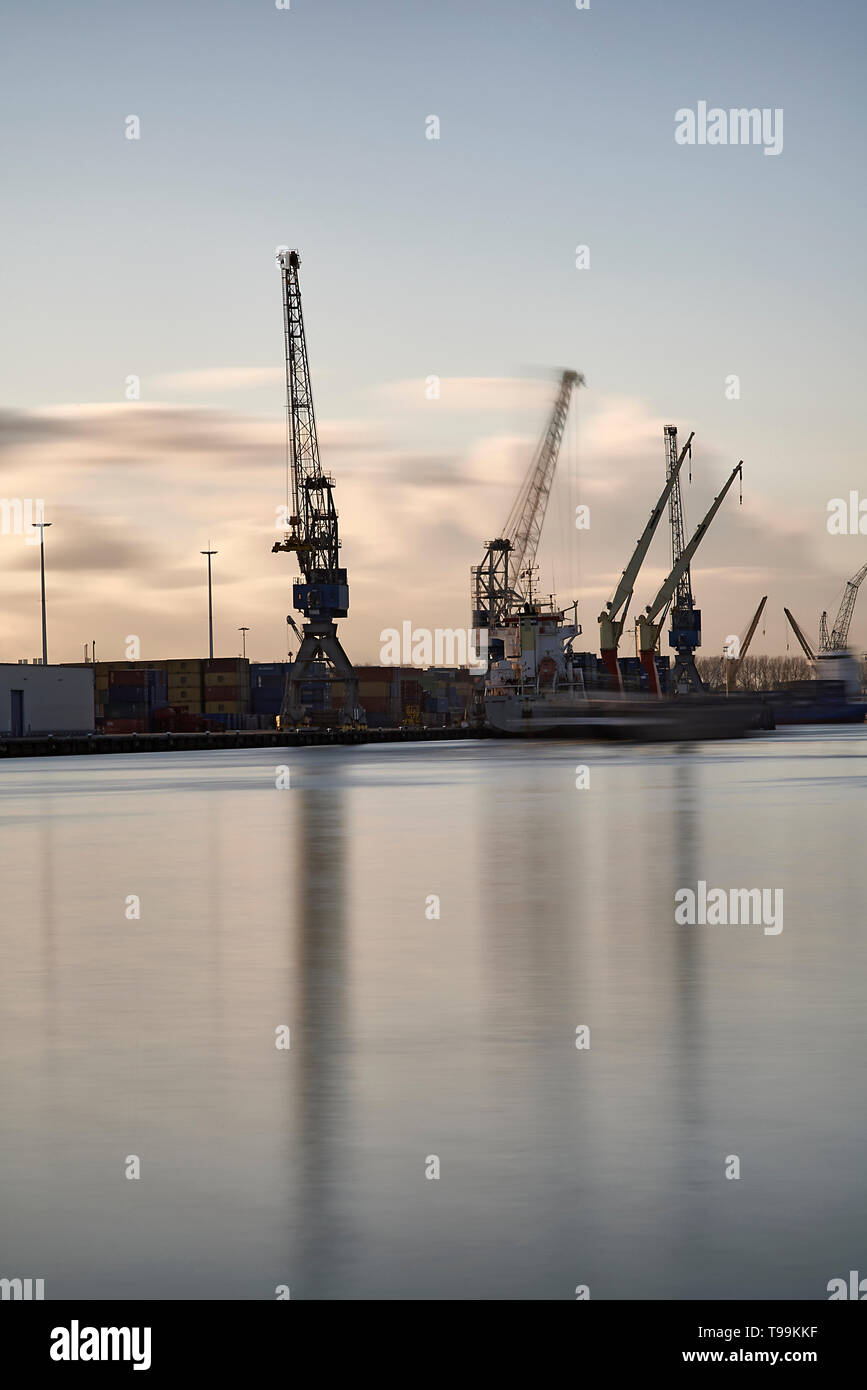 Cranes and containerships in the Port of Rotterdam in spring sunshine - Stock Image