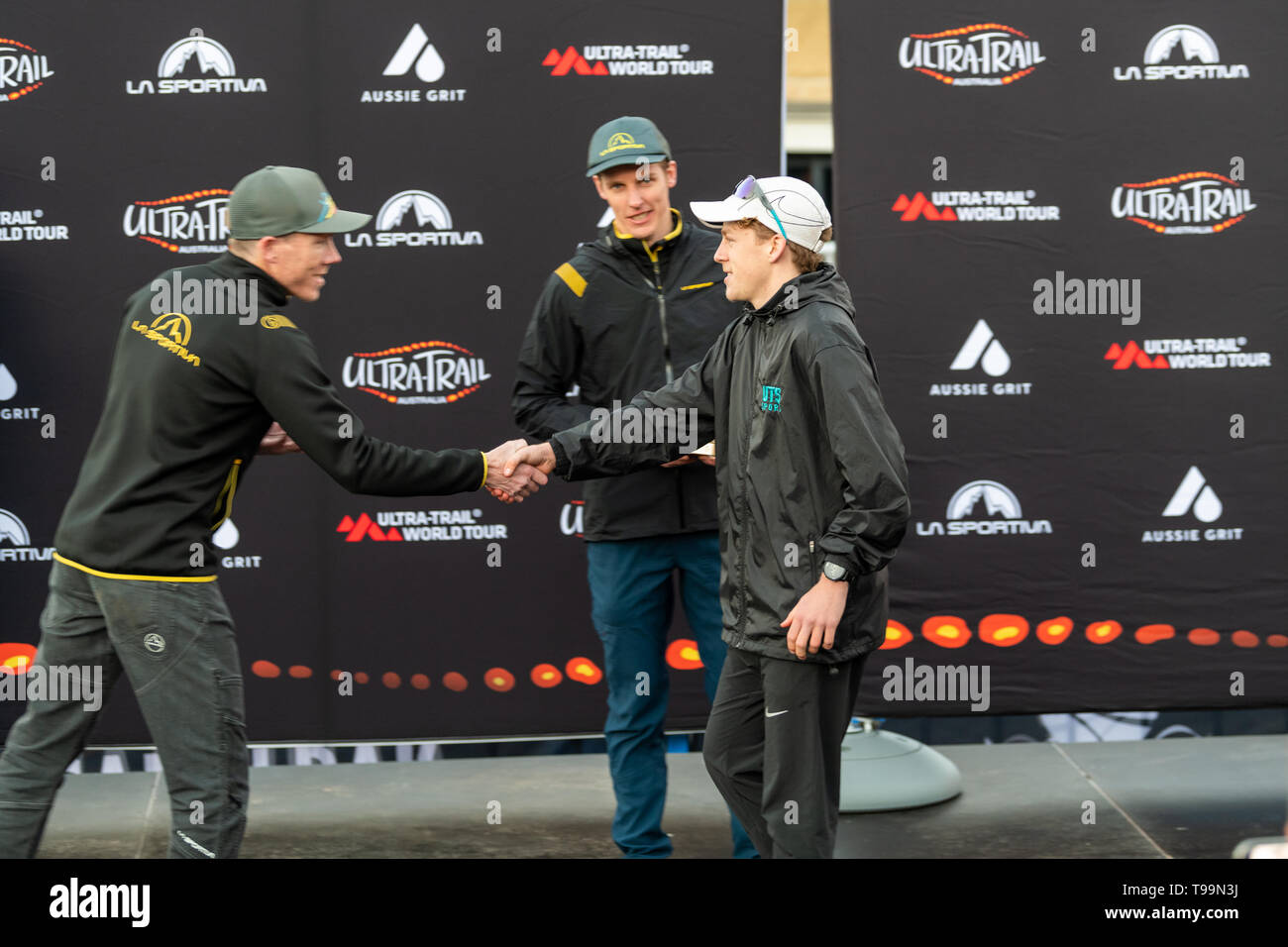 Blue Mountains, Australia - April 16 2019: Ultra-Trail Australia UTA11 race. WIll Atkinson, over all race runner up (2nd place) shakes hand with spons - Stock Image
