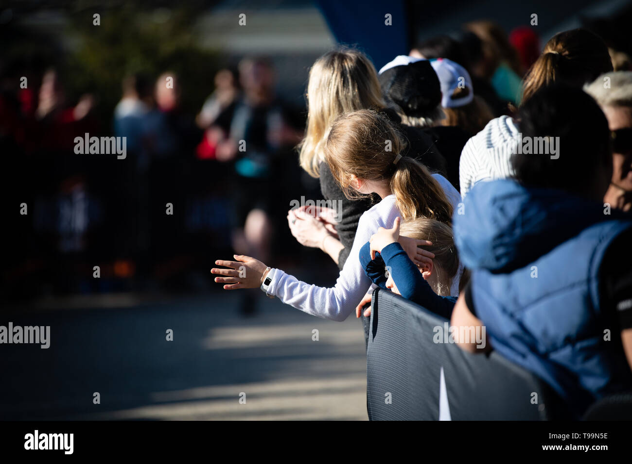 Blue Mountains, Australia - April 16 2019: Ultra-Trail Australia UTA11 race. Crowd watches runners about to finish on home stretch. - Stock Image