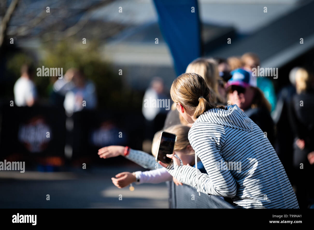 Blue Mountains, Australia - April 16 2019: Ultra-Trail Australia UTA11 race. Crowd watch and wait for runners about to finish on home stretch. - Stock Image