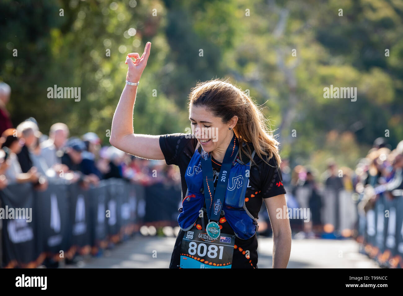 Blue Mountains, Australia - April 16 2019: Ultra-Trail Australia UTA11 race. Runner Jo Nevin, 3rd place overall, happy with her success at the finish  - Stock Image