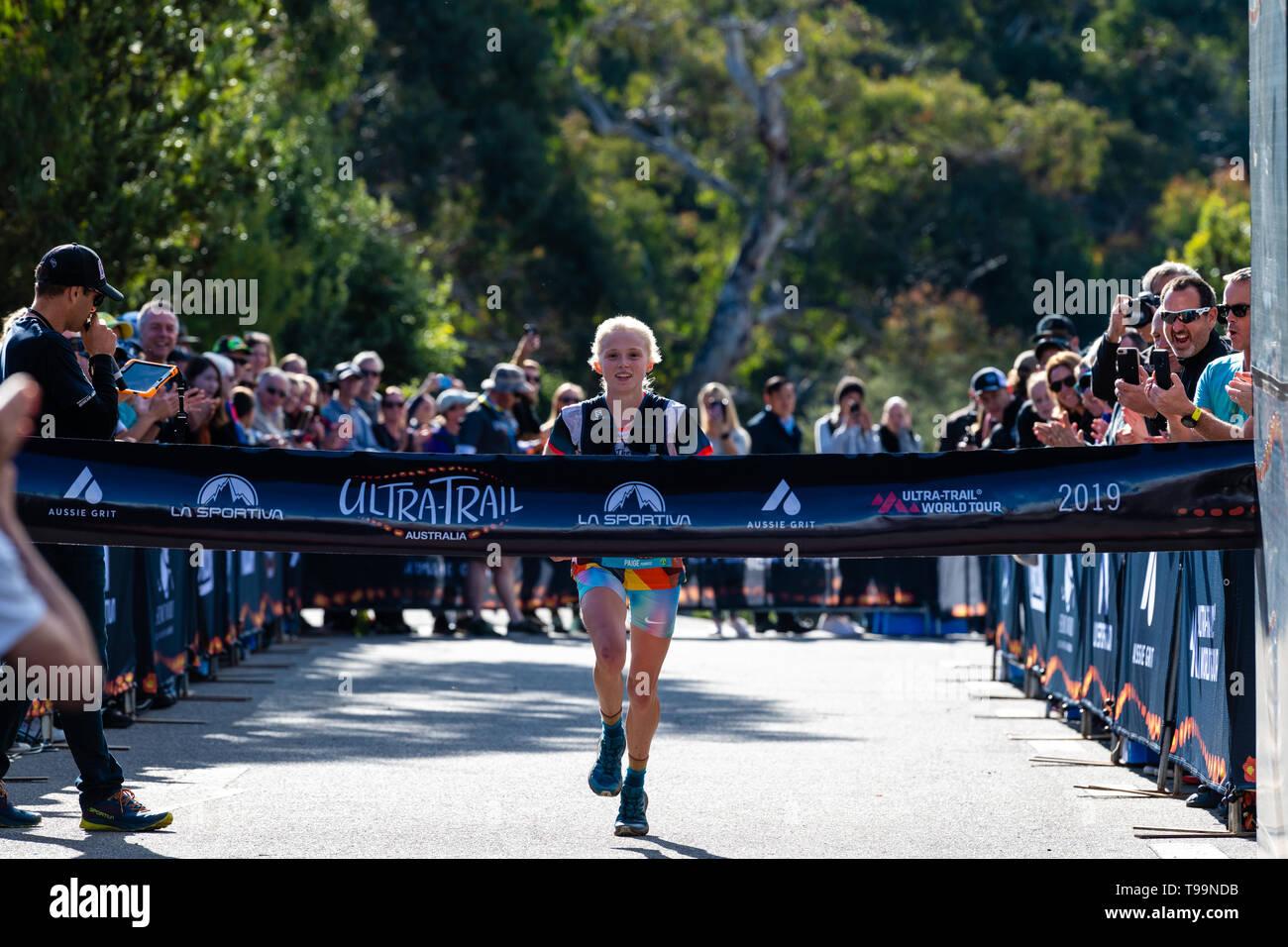 Blue Mountains, Australia - April 16 2019: Ultra-Trail Australia UTA11 race. Runner Paige Penrose, winner of the womens event, at the finish line. - Stock Image