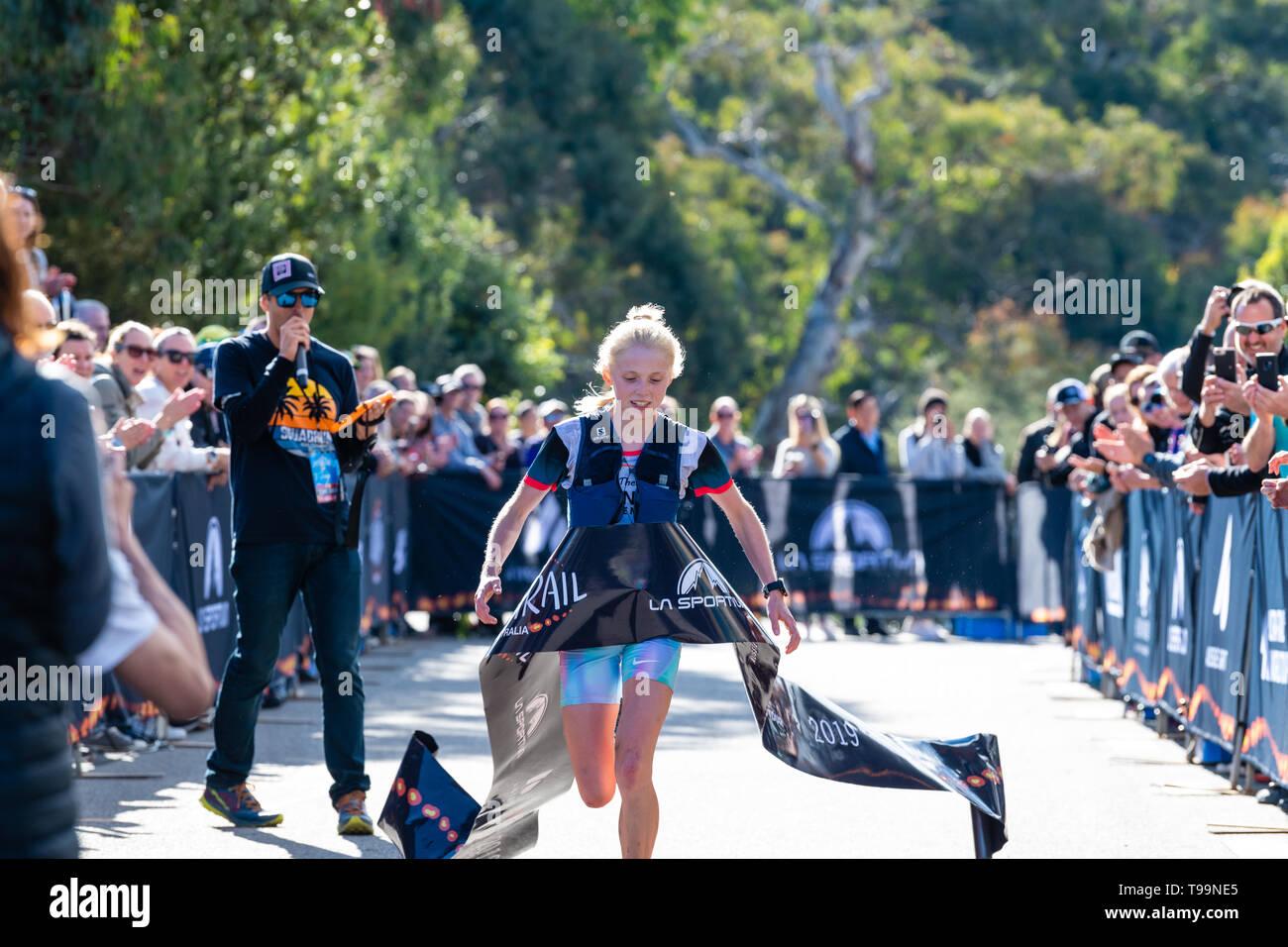 Blue Mountains, Australia - April 16 2019: Ultra-Trail Australia UTA11 race. Runner Paige Penrose, overall winner of womens event, at the finish line. - Stock Image
