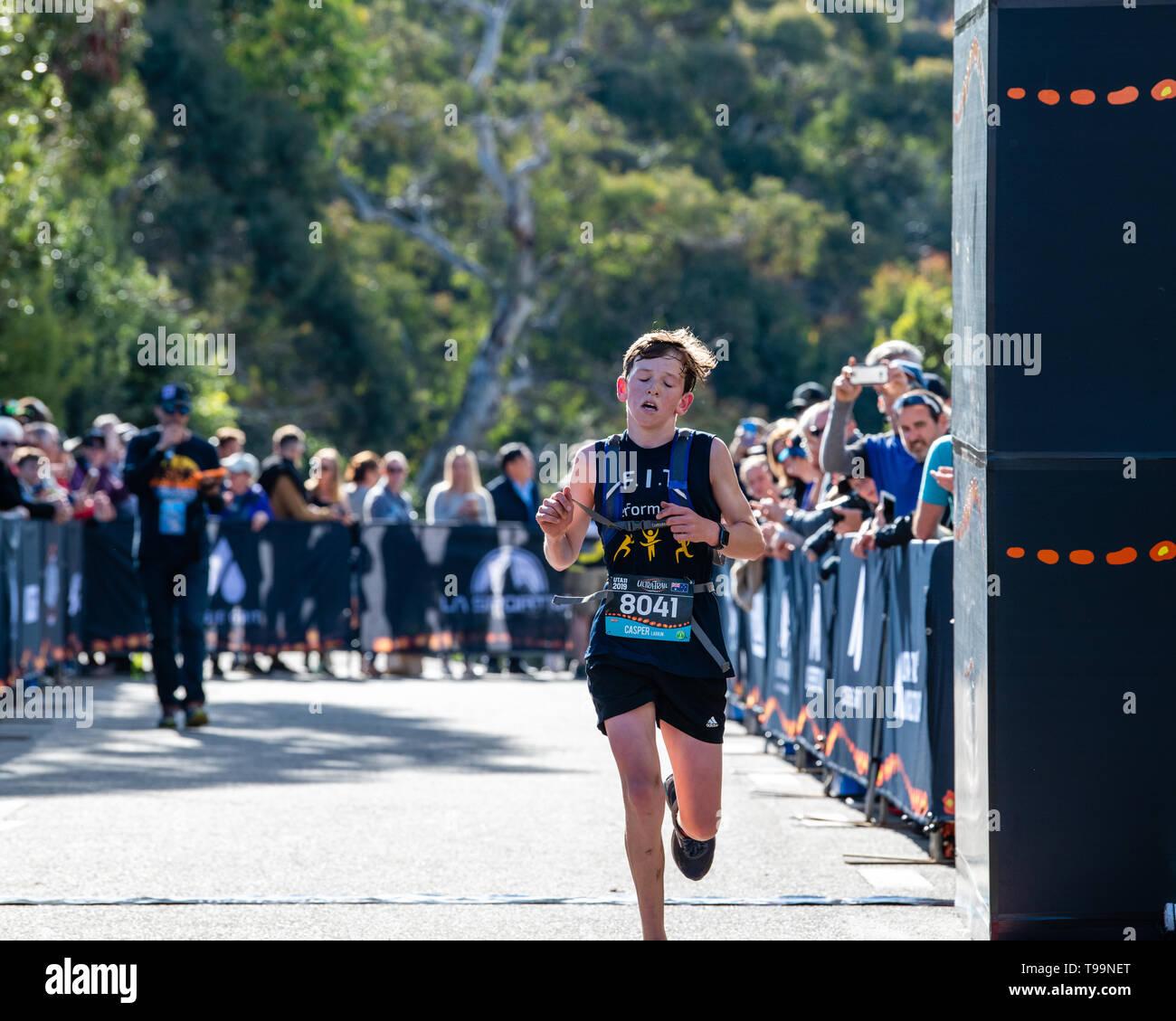 Blue Mountains, Australia - April 16 2019: Ultra-Trail Australia UTA11 race. Runner Capser Larkin crosses at the finish line. - Stock Image