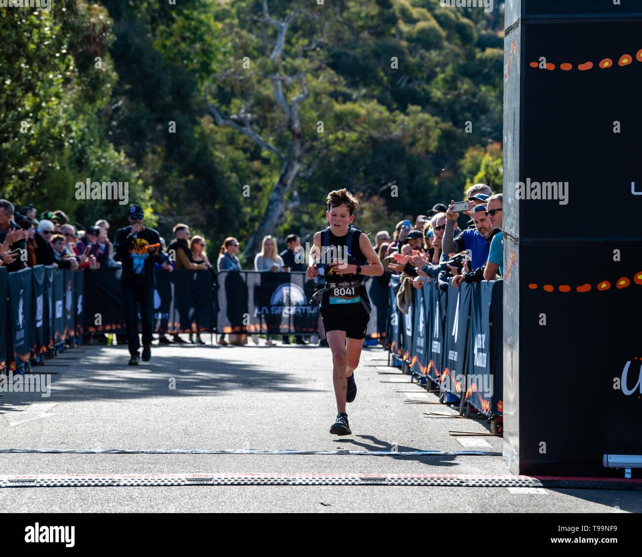 Blue Mountains, Australia - April 16 2019: Ultra-Trail Australia UTA11 race. Runner Capser Larkin closes in at the finish line. - Stock Image