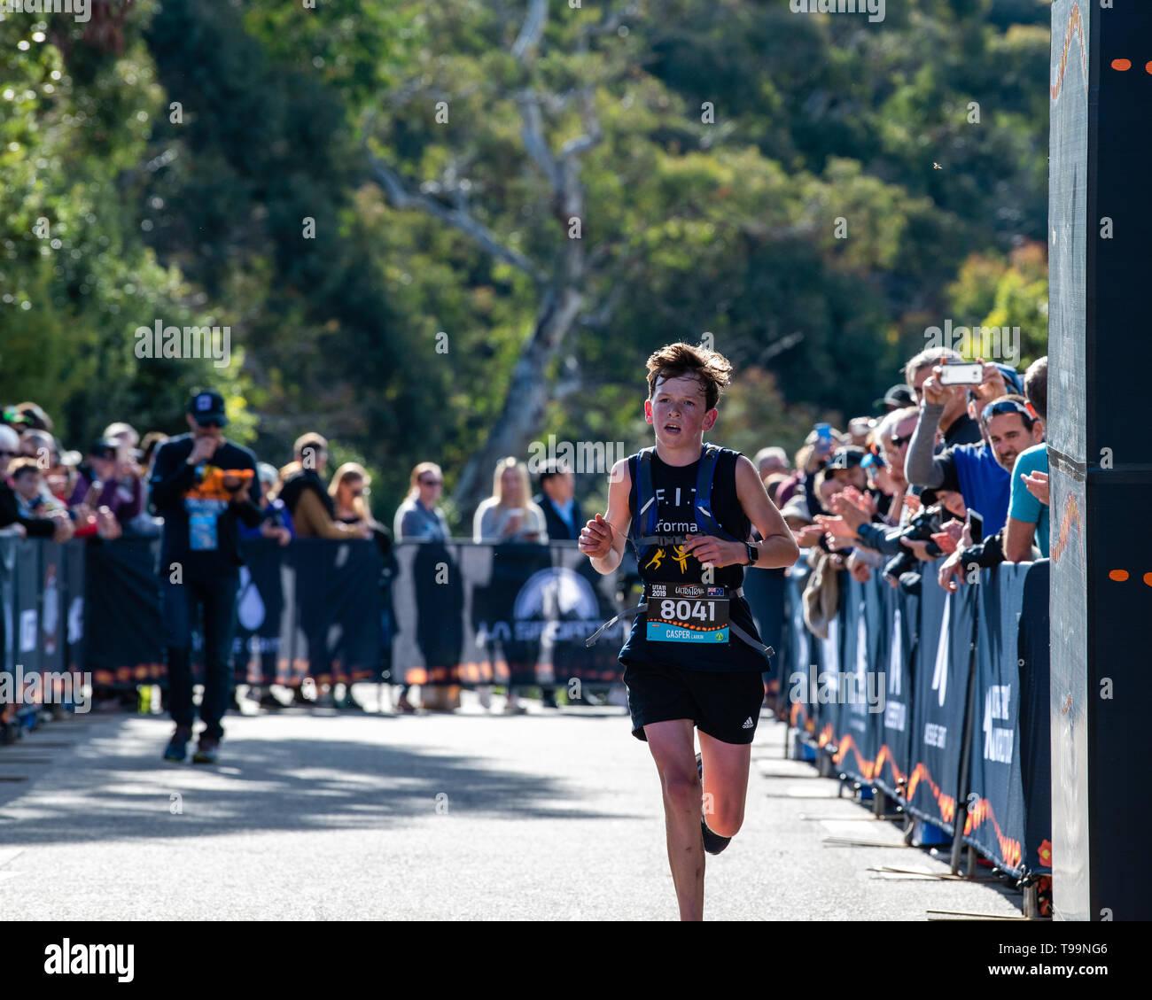 Blue Mountains, Australia - April 16 2019: Ultra-Trail Australia UTA11 race. Runner Capser Larkin almost there at the finish line. - Stock Image