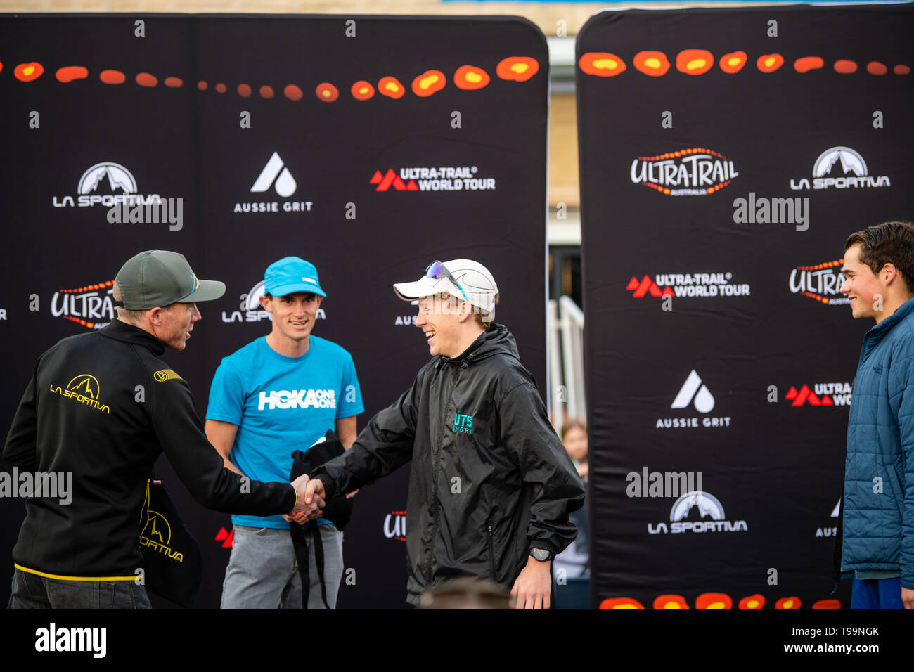 Blue Mountains, Australia - April 16 2019: Ultra-Trail Australia UTA11 race. Over all runner up Will Atkinson shakes hand and receives his prize. - Stock Image