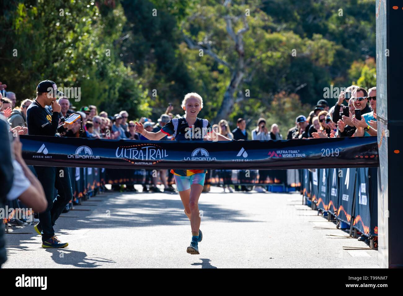 Blue Mountains, Australia - April 16 2019: Ultra-Trail Australia UTA11 race. Runner Paige Penrose, winner of the womens event, at the finish line, abo - Stock Image