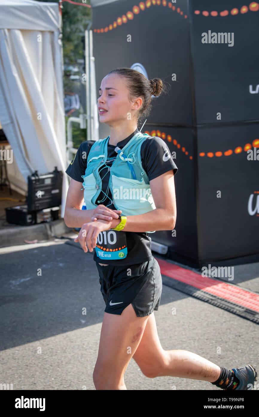 Blue Mountains, Australia - April 16 2019: Ultra-Trail Australia UTA11 race. Runner Sophie Butler clocks off at the finish line. - Stock Image