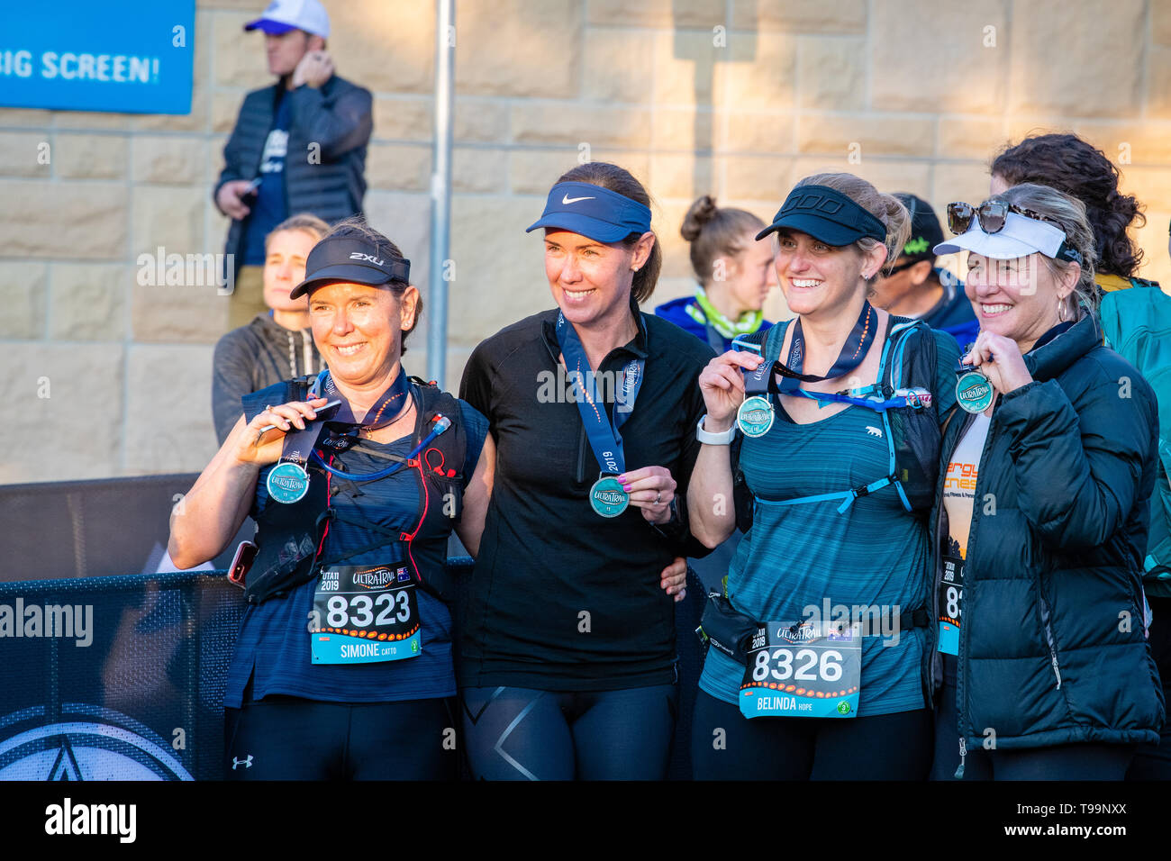Blue Mountains, Australia - April 16 2019: Ultra-Trail Australia UTA11 race. Group of women celebrate their sucess at the race finish. Stock Photo