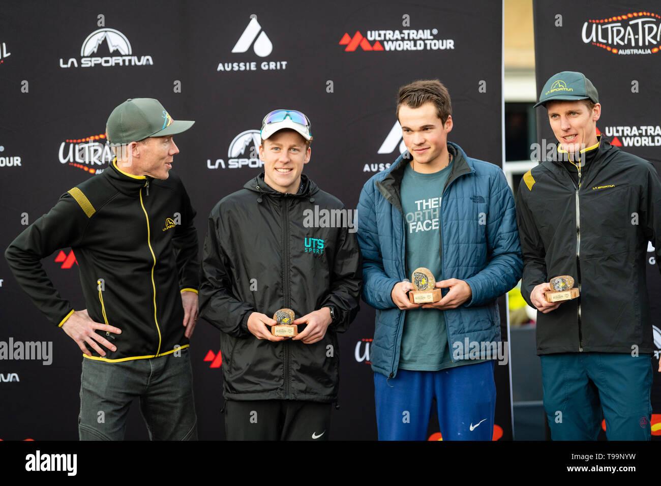 Blue Mountains, Australia - April 16 2019: Ultra-Trail Australia UTA11 race. Over race place getters on podium with sponsor from La Sportiva - Stock Image