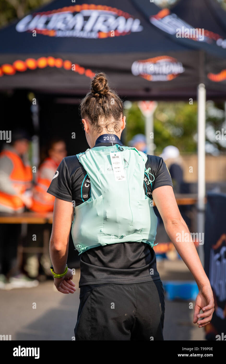 Blue Mountains, Australia - April 16 2019: Ultra-Trail Australia UTA11 race. Runner Sophie Butler at the finish line, head off to time keepers. - Stock Image