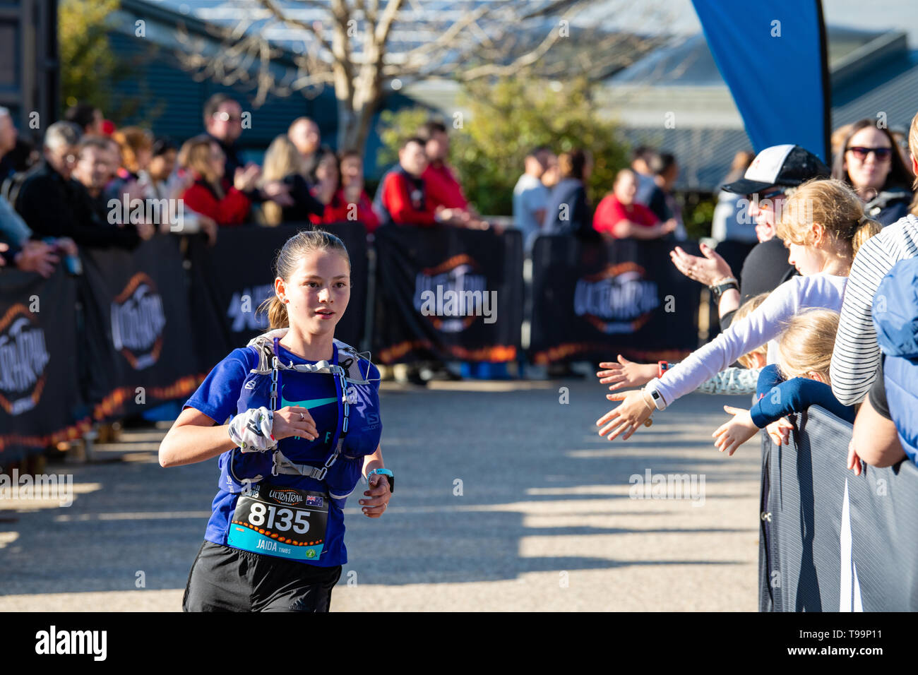 Blue Mountains, Australia - April 16 2019: Ultra-Trail Australia UTA11 race. Runner about to finish rounds the bend on home stretch. - Stock Image