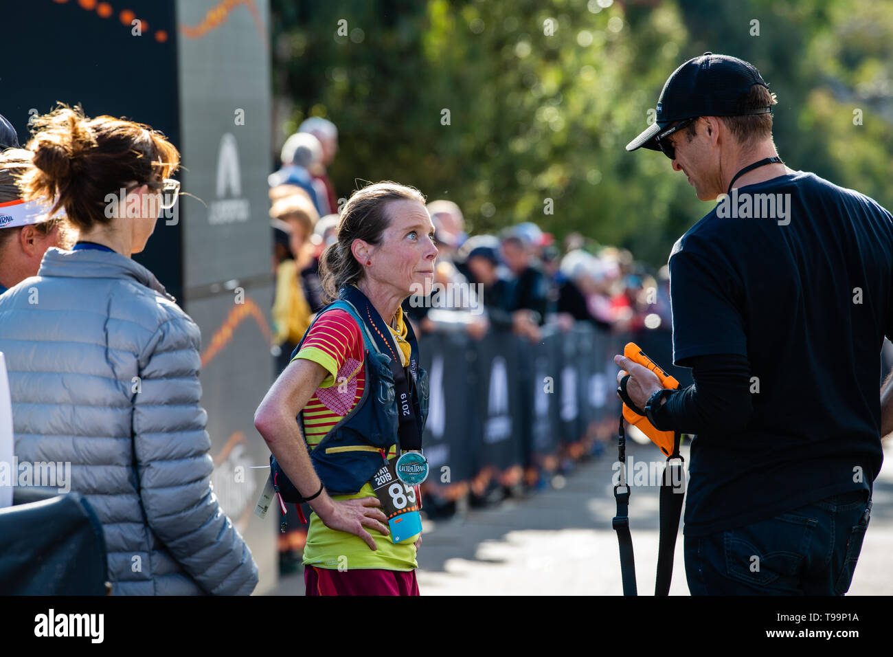 Blue Mountains, Australia - April 16 2019: Ultra-Trail Australia UTA11 race. Runner Beth Cardelli, 2nd place, has an interview at the finish line. - Stock Image