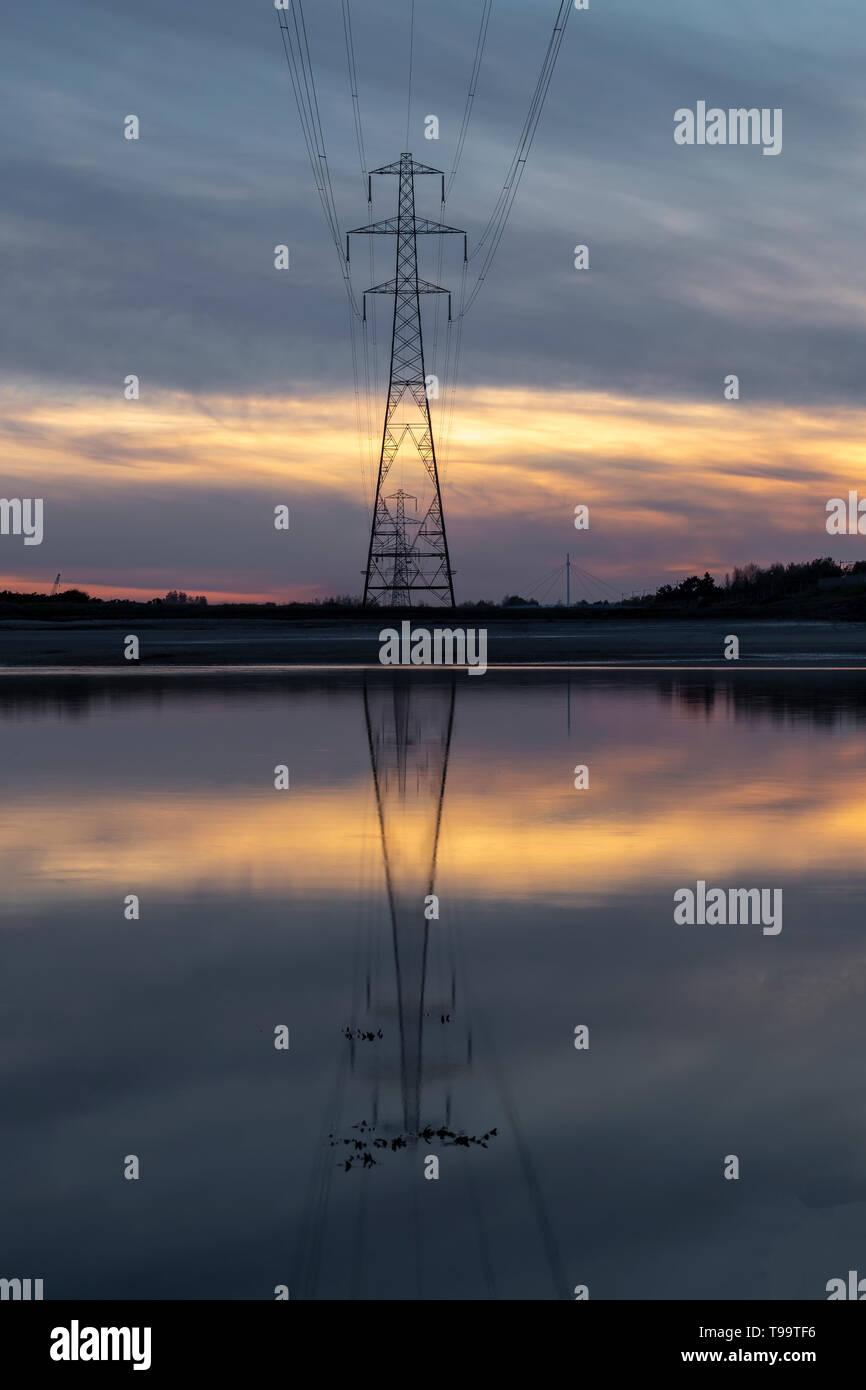 Pylon reflection on the Loughor estuary Stock Photo