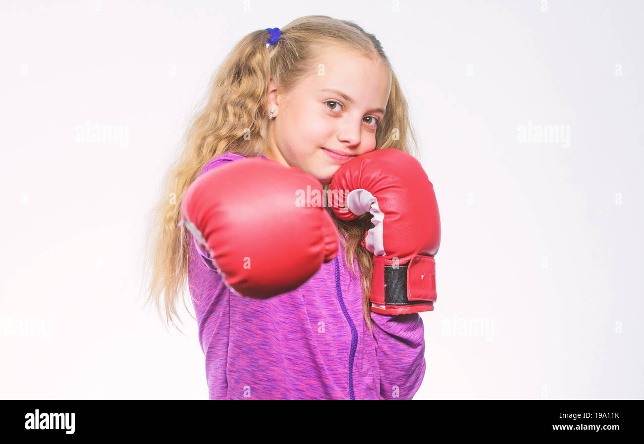Boxer child workout, healthy fitness. training with coach. Fight. Sport and sportswear fashion. knockout and energy. Sport success. little girl in boxing gloves punching. sportswear fashion. - Stock Image
