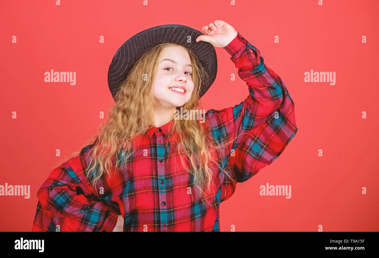 Enter acting academy. Girl artistic kid practicing acting skills with black hat. Acting school for children. Acting lessons guide children through wide variety of genres. Develop talent into career. - Stock Image
