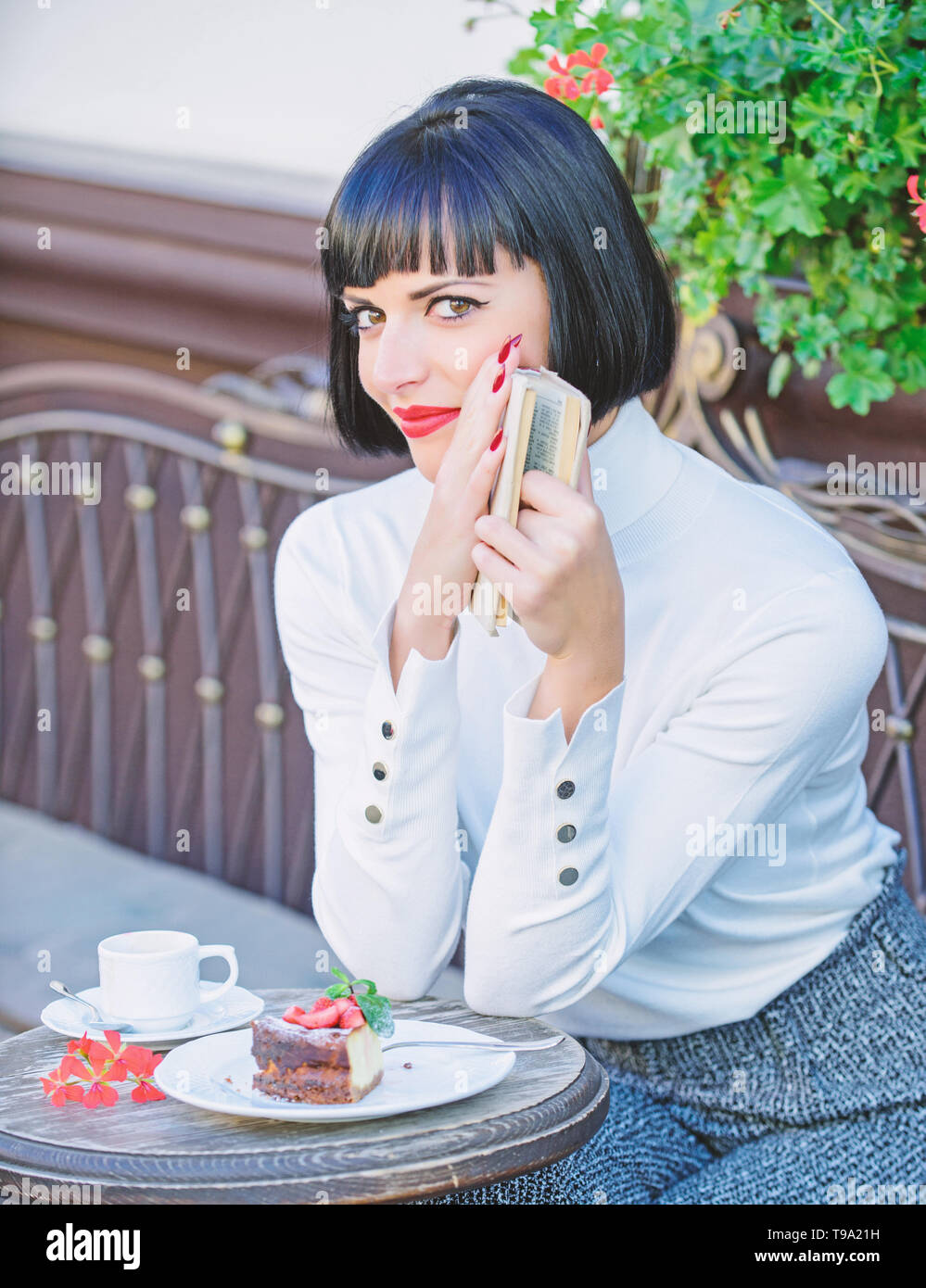 Self improvement concept. Woman have drink enjoy reading good book cafe terrace. Modern literature for female. Business lady read book during coffee break. Coffee and good book for perfect weekend. - Stock Image