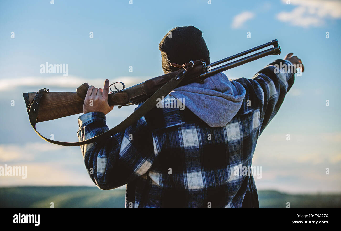 Noticed game. Man brutal unshaved gamekeeper nature background. Hunting permit. Hunting brutal masculine hobby. Hunting and trapping seasons. Bearded serious hunter spend leisure hunting. Look there. - Stock Image